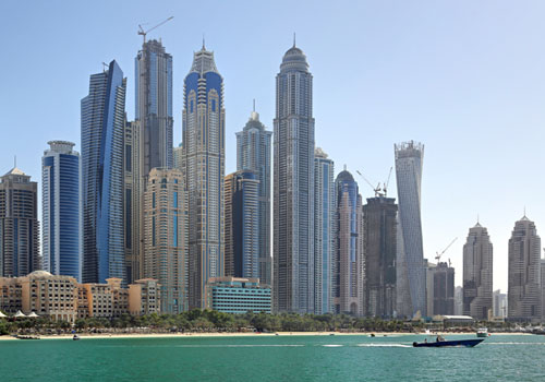 Picture of very tall building in Dubai by the water