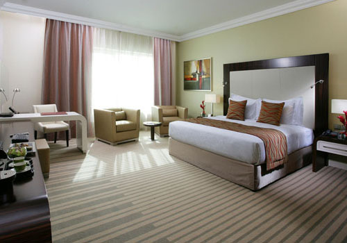 Bed room in hotel with pastel and beige decor