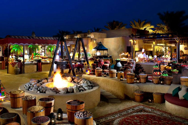 Restaurant in Bab Al Sham resort at night