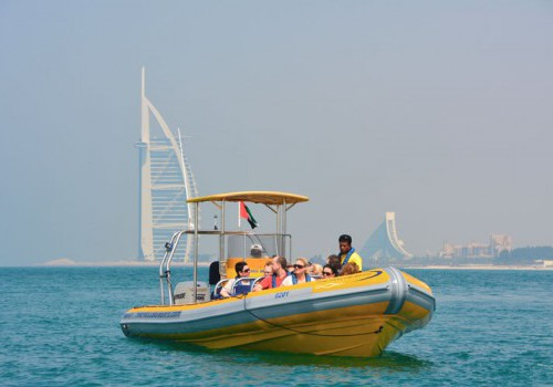A yellow rubber sightseeing boat in front of Burj Al Arab