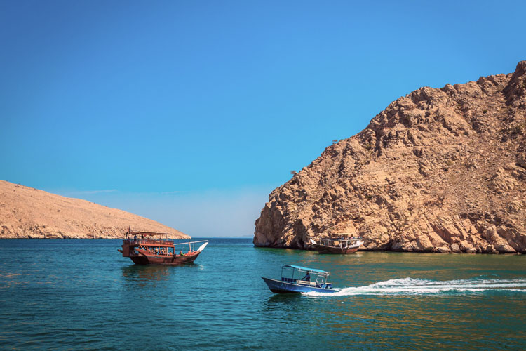 Fjord with traditional boats in Northern Oman
