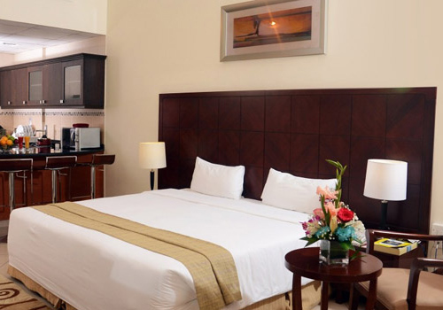 King bed in Rose Garden Hotel Apartments