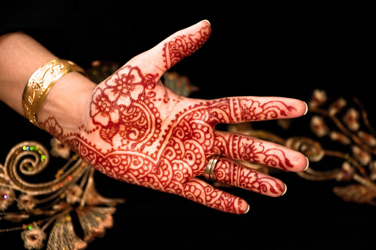 Female hand with traditional brown coloured henna decoration