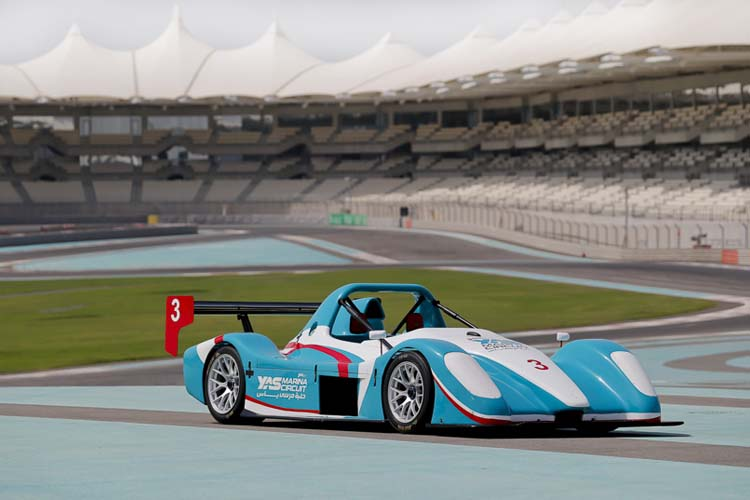Blue sports car at a race track in Abu Dhabi