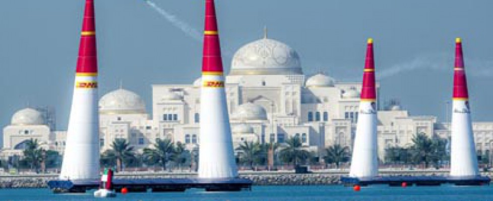Airplane flies above the water in Abu Dhabi for the Red Bull Air Race