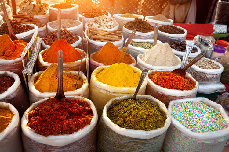 Colourful spices in sacks in a market