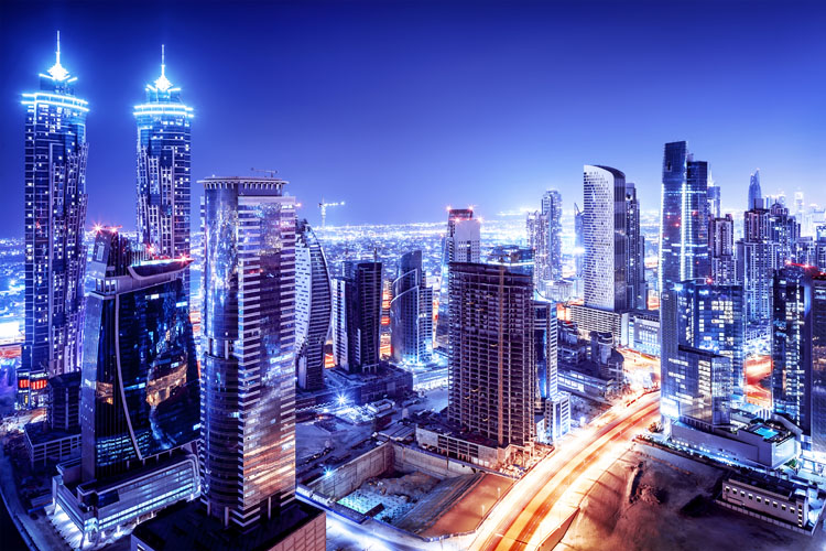Blueish picture of Dubai skyline at night