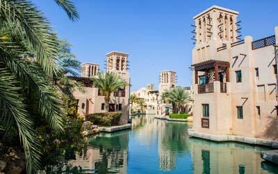 Houses standin along a water channel in Dubai