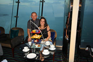 A couple is eating high tea in a hotel